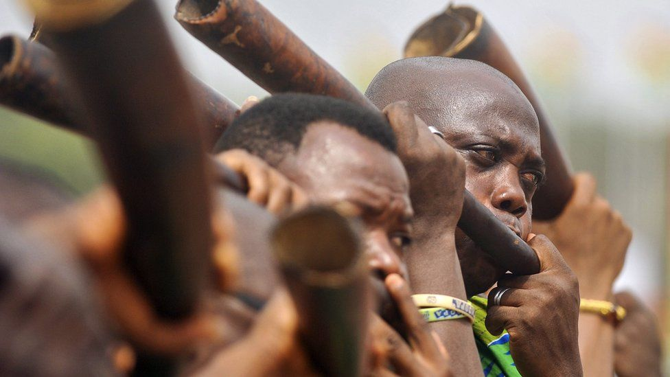 Men blowing horns during the official inauguration ceremony for Ghana's new president Nana Akufo-Addo