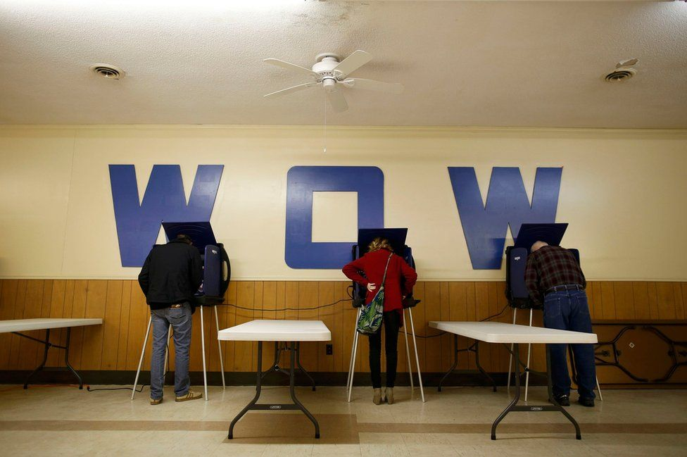 People vote at the Woodman of the World (WOW) Lodge during the US presidential election in Florence, South Carolina