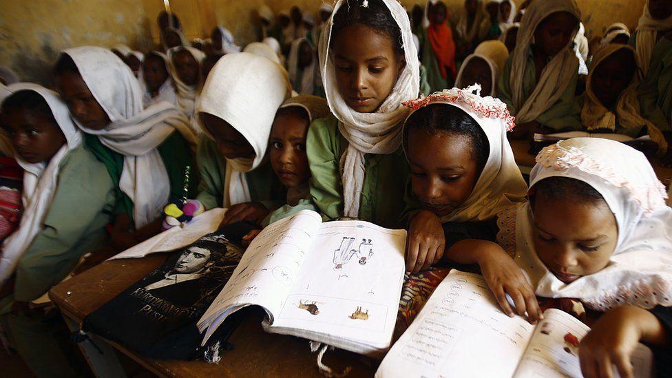 Girls reading books in a classroom in El-Riyadh camp in Geneina, West Darfur, Sudan - Wednesday 8 February 2017