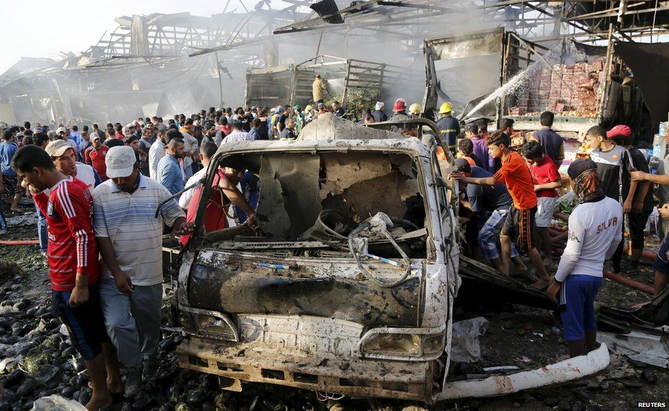 Residents gather at the site of a truck bomb attack at a crowded market in Baghdad ,August 13,2015.
