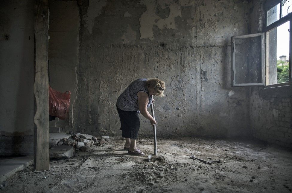 Maia Daiauri, aged 45, begins to prepare a former hospital room into a liveable environment