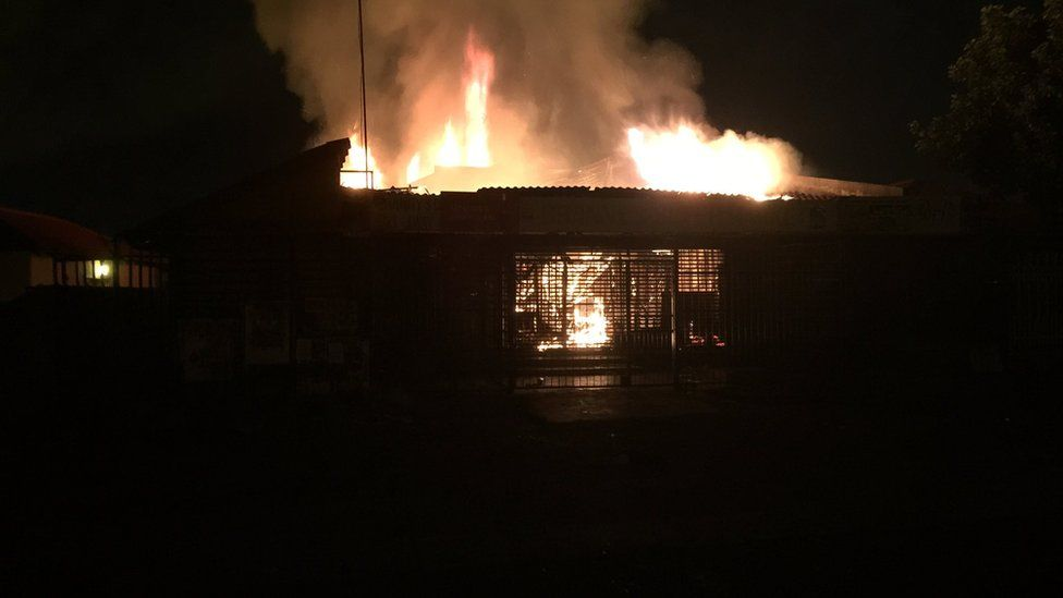 A grocery shop that was set alight near Pretoria, South Africa