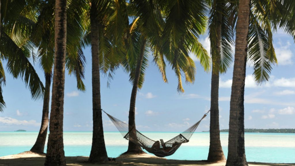 Magnata britânico oferece férias ilimitadas aos funcionários - BBC ...