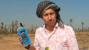 BBC journalist with a satellite housing in a desert of Morocco