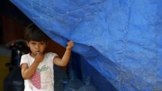 Niña siria en un campo de refugiados