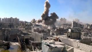 Barzeh, durante bombardeiros em setembro (AP)