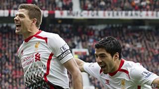 Steven Gerrard y Luis Suárez celebran el triunfo