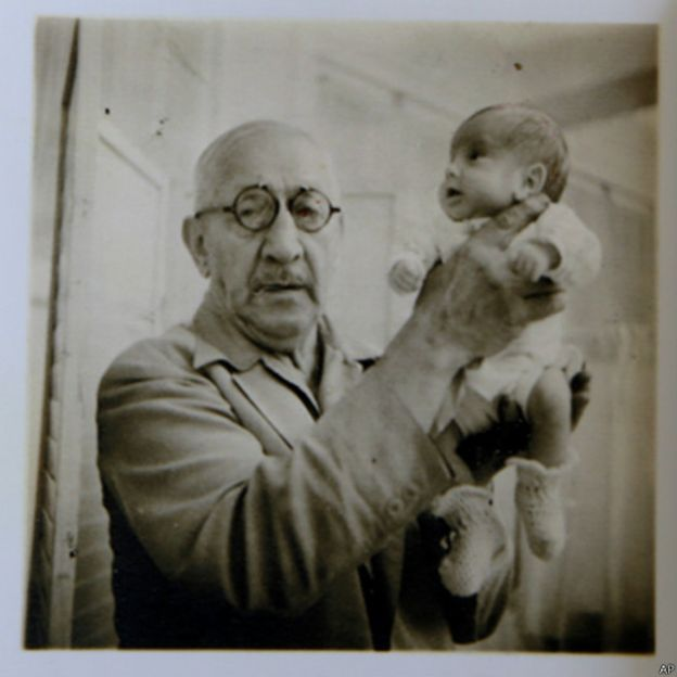 Dr. Martin Couney holding Beth Allen, one of the premature babies who was born in 1941 and participated in his exhibition in Coney Island, New York.