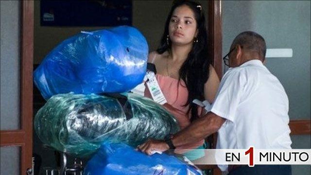 Cubanos con paquetes