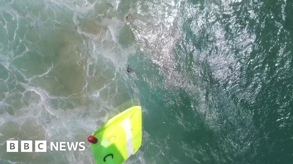 Drone saves teen swimmers in world first