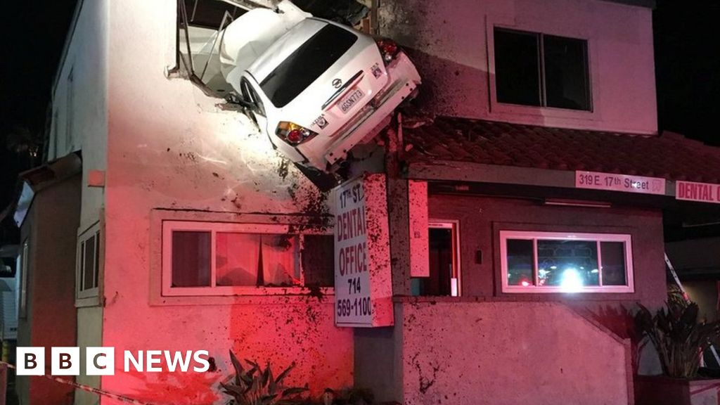 Car hurled into upper floor of building
