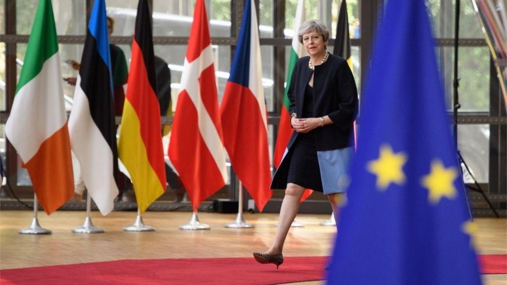 Theresa May arrives at the summit