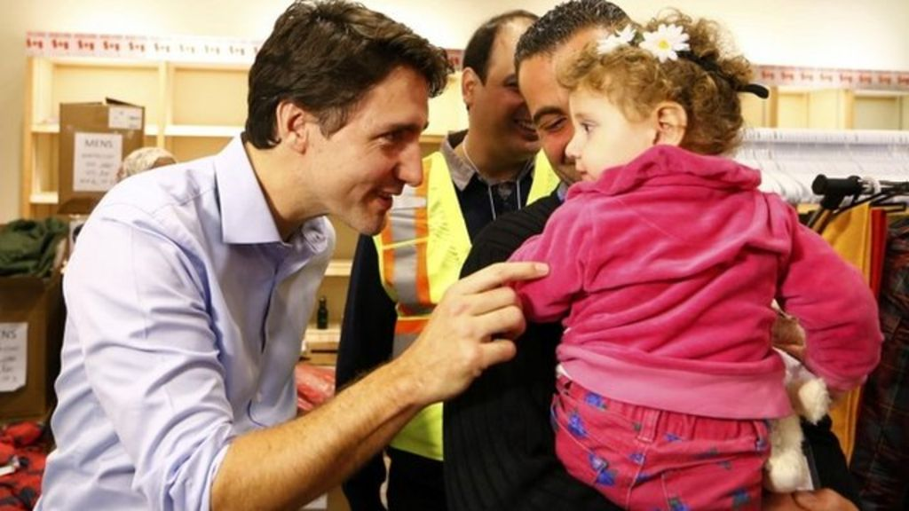 Canada prime minister welcomes wave of Syrian refugees - BBC News