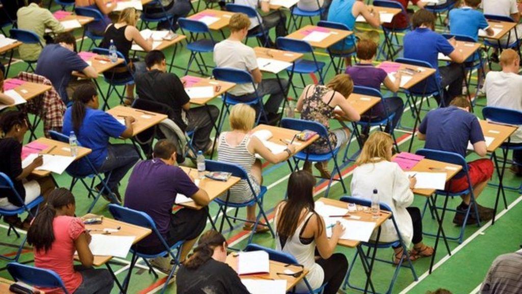 GCSEs 'need tougher pass mark to catch international rivals' - BBC News