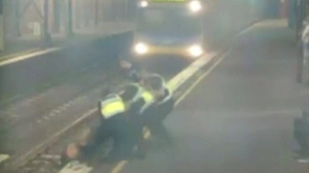 bbc.co.uk - Woman dragged from tracks in narrow escape