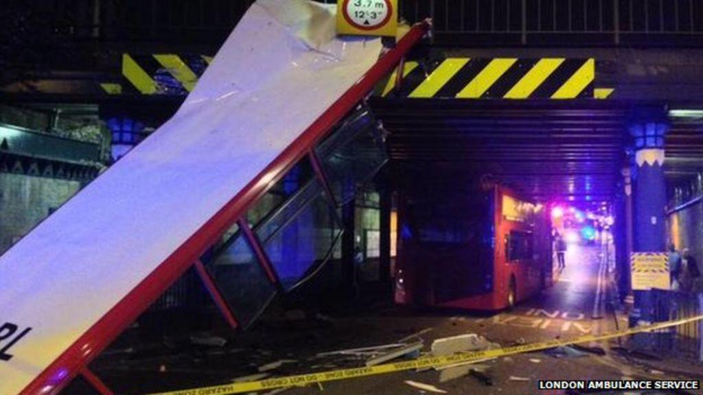 Seven hurt as bus crashes into bridge