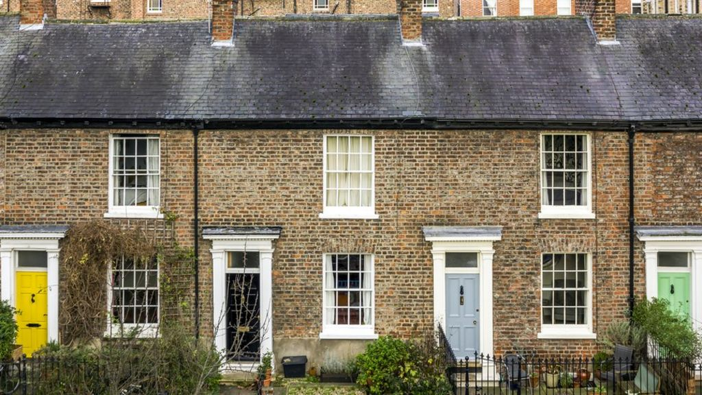 UK house prices fall further in June, says Halifax