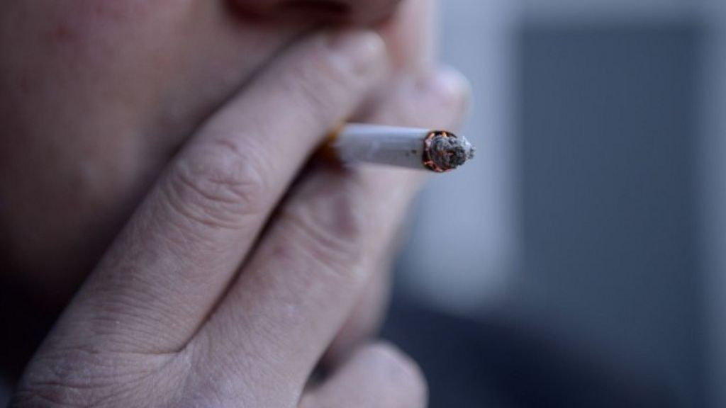 Cigarettes sold in plain green packs under new rules - BBC News