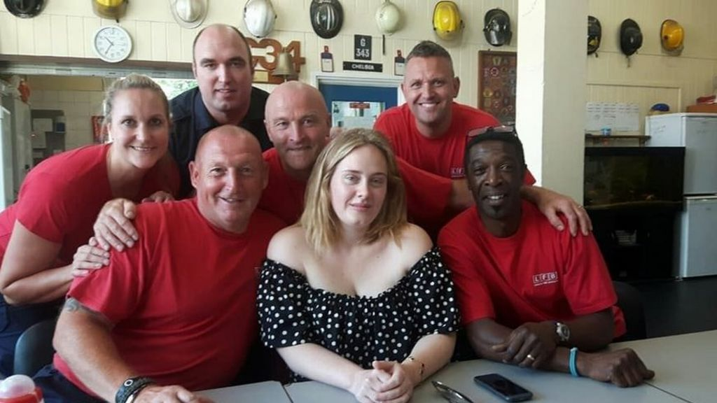 Adele surprises Grenfell Tower fire fighters with cake