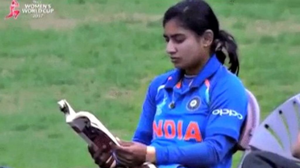 India cricketer reads book before batting
