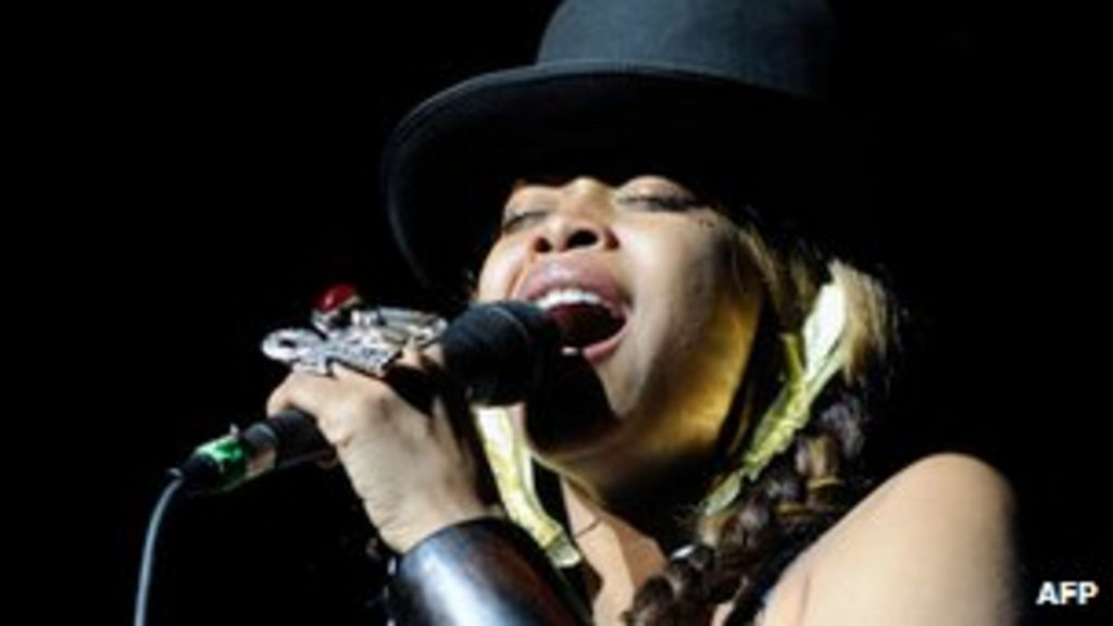 Malaysia cancels erykah badu show over 39 allah tattoos for Erykah badu real tattoos