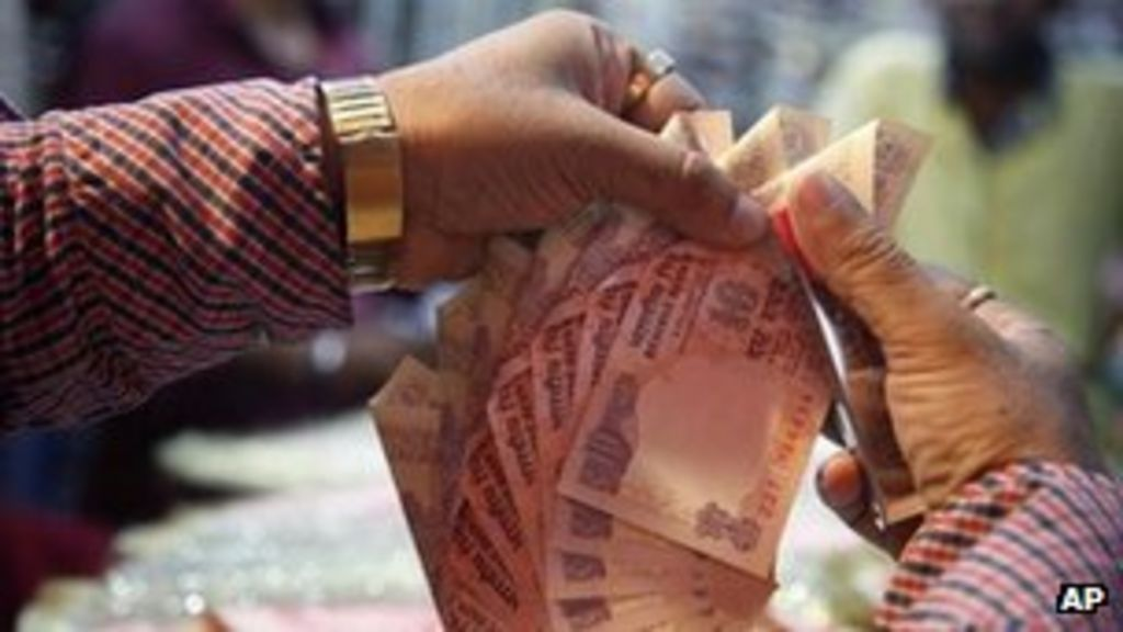 Indian rupee falls to new low against us dollar bbc news for Aum indian cuisine