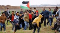 Twelve people have been killed in clashes on the Gaza-Israel border.