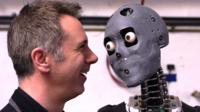 Spencer Kelly (L) and a humanoid robot (R)