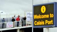 Syrian refugees at a ferry terminal at the Calais port