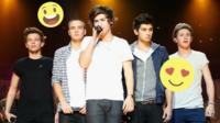 The five members of 1D together on stagem Harry sings into a microphone.