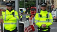 Police officers work near London Bridge