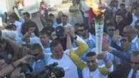 Ibrahim al-Hussein carries Olympic torch