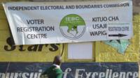 A school boy looks at a banner advertising a voter-registration point January 18, 201