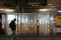 Man walking in a closed train station