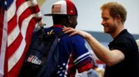 Prince Harry talks to US army sergeant