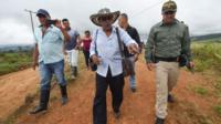 FARC rebels commander Joaquin Gomez (C) arrives at the Transitional Standardization Zone Mariana Paez, Buena vista, Mesetas municipality, Colombia on June 26, 2017,