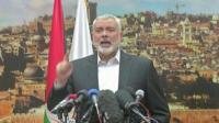 Ismail Haniya stands at a podium with microphones