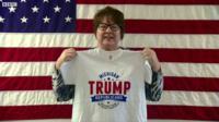 "Woman holds up ""Michigan Trump Republicans"" shirt"