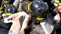 Middle brother Mattias rescued from the rubble by a firefighter