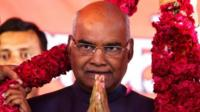 Supporters of Ram Nath Kovind, nominated presidential candidate of India's ruling Bharatiya Janata Party (BJP), present him with a garland during a welcoming ceremony as part of his nation-wide tour, in Ahmedabad, India, July 15, 2017