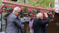 Saffie Roussos' coffin being carried into church