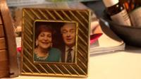 A framed photo of David Parry-Jones and Beti George