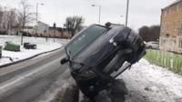 Car on its side