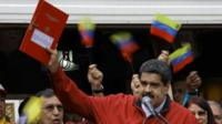 "Venezuela""s President Nicolas Maduro holds a document with the details of a ""constituent assembly"" to reform the constitution during a rally at Miraflores Palace in Caracas, Venezuela May 23, 2017."