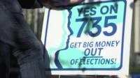 "Sign by activist Matthew Strieb asking for ""Big money"" to be removed from elections"