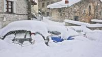 Snow covered cars in Spain