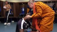 Thai monk blessing Leicester City player's head in changing room