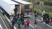 Immigrants trying to board lorry in Calais