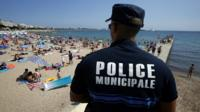 French policeman looking over Cannes beach