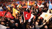 Supporters of Turkey's Justice and Development Party (AKP) celebrate outside the party's headquarters in Ankara